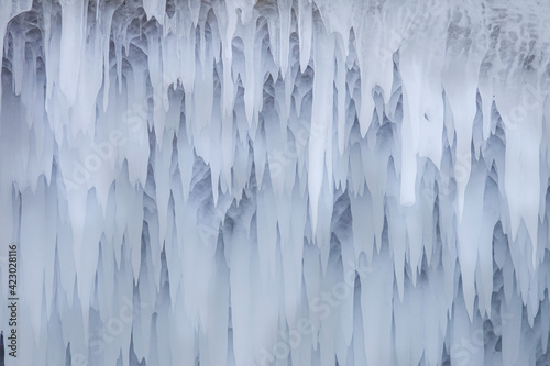Ice Grotto with Icicles at Baikal Lake in Russia Wallpaper Mural