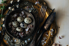 Vintage Or Rustic Easter Table Setting From Above. Plate, Cutlery, Eggs On And Natural Spring Branch On Rustic Wood. Country Style. Copy Space. Toned Image.