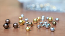 Fly Knitting Accessories. Brass And Tungsten Beads Of Different Diameters.