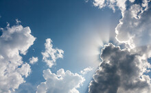 Blue Sky With Clouds. Crepuscular Rays Or God Rays. Epic Cloudy Sky With Holy Sun Light Beams.
