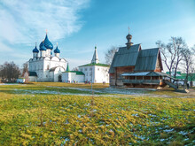White Stone Orthodox Church And Old Wooden Church In Suzdal. Journey Through The Golden Ring Of Russia