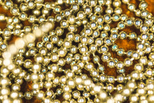 Shiny Golden Beads Background And Close-up