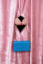 Crop Unrecognizable Female With Manicure Demonstrating Stylish Blue Purse With Chain Through Velvet Fabric Hole