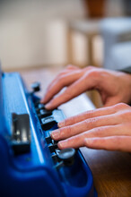 Crop Anonymous Visually Impaired Male Typing On Typewriter With Tactile Writing System At Home