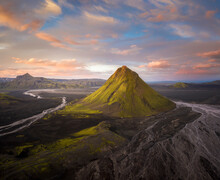 Amazing Peaceful View Of Rough Hilly Terrain Covered With Lush Verdant Greenery In Icelandic Countryside
