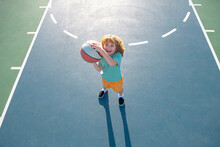 Little Boy Playing Basketball. Child Sport Activity. Kids Basketball School.