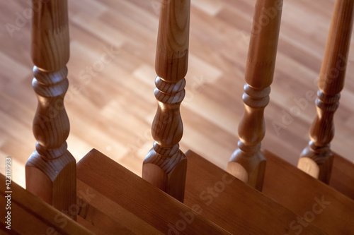 Papel de parede Element of a wooden interior staircase. Wooden baluster close-up.