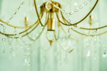 Crystal Chandelier Close-up. Celadon Green Light. Selective Focus.