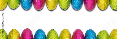 Foil wrapped chocolate Easter egg borders.