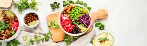 Obraz na plátně Tasty colorful vegan poke bowl on light gray background.