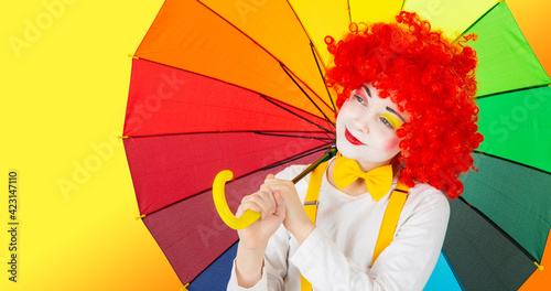 Obraz na plátně children in colorful clown outfits, isolated on a white background