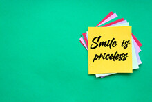 Text Smile Is Priceless On The Short Note Texture Background