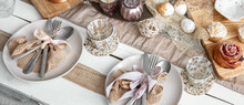 Easter Table Setting With Decor Details And Homemade Cakes Top View.