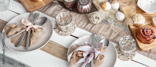 Obraz Easter table setting with decor details and homemade cakes top view. - fototapety do salonu