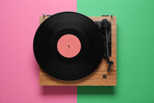 Modern Turntable With Vinyl Record On Color Background, Top View