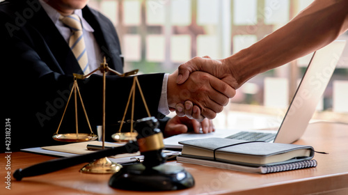Fotografie, Obraz The Lawyer is currently shaking hands with the client about the success in resolving the case