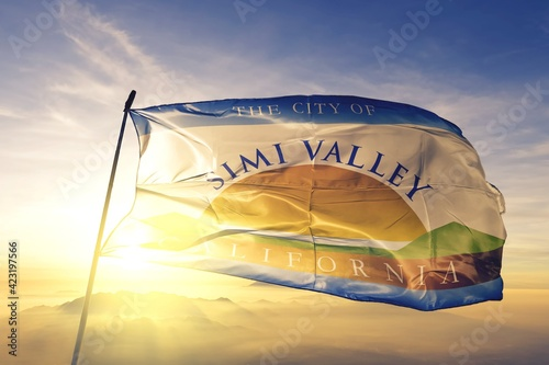 Obraz na plátne Simi Valley of California of United States flag waving on the top