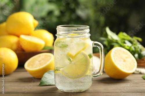 Obraz Mason jar of cold lemonade on wooden table - fototapety do salonu