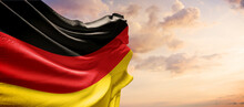 Germany Flag In The Blue Sky. Horizontal Panoramic Banner.