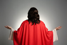 Jesus Christ With Outstretched Arms On Light Grey Background, Back View