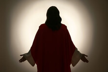 Silhouette Of Jesus Christ With Outstretched Arms On Color Background, Back View