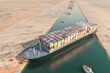 Leinwandbild Motiv Maritime traffic jam. Container cargo ship run aground and stuck in Suez Canal, blocking world's busiest waterway. Ever given grounding 3D illustration. Cargo vessels traffic jam grows in Suez canal