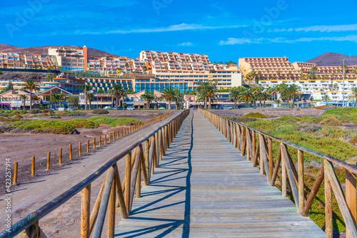 Fototapeta Holiday apartments behind a nature reserve at Morro Jable, Fuerteventura, Canary