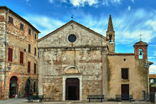 Stone, Medieval Church With A Bell Tower In The Village Of Magliano In Toscana