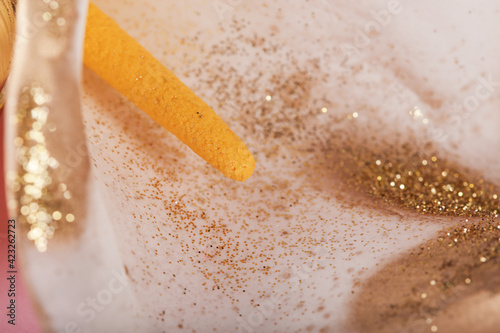 Fototapeta yellow pistil in gold sequins