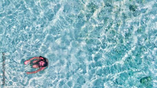 Young girl enjoying a beautiful beach shoreline Fototapeta