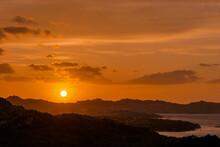 Sun Setting Beyond Palau In Sardinia