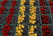 Close Shot Of Colorful Boxes Of Cherries And Mixed Berries At Farmers Market, Portland, Maine