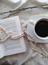 A Cup Of Coffee, Pearl Beads, An Open Book And Pussy Willow Branches