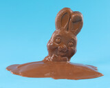 Fototapeta Kawa jest smaczna - Chocolate Easter bunny rabbit melting into a puddle. Disappointment Easter concept.