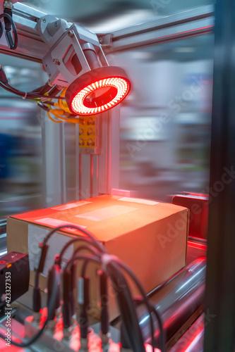 Obraz Robotic vision sensor camera system in intellegence cardboard box of product packaging - fototapety do salonu