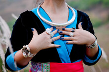 Close Up Shot Of Woman With Silver Choker, Bangles And Rings
