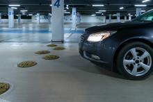 Garage Interior. Car Lot Parking Space In Underground City Garage. Empty Road Asphalt Background. Large Private Garage.