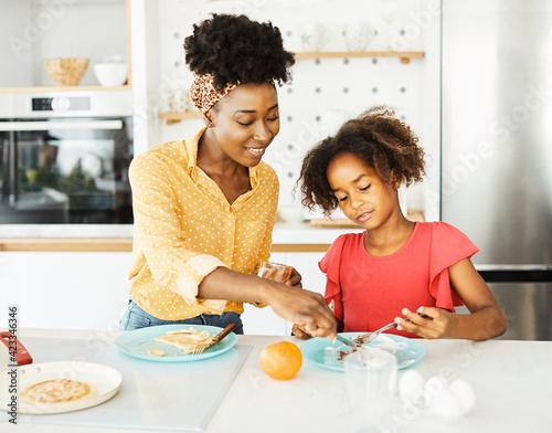 Fotografie, Obraz family child kitchen food daughter mother love eating preparing pancake breakfas