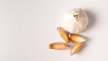 Top View Of Garlic Isolated On White Background. Raw Garlic Segment Isolated With Copy Space. White Garlic Head