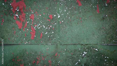 Zielona blacha z odpryskami stanowiąca tło