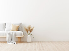 Interior Wall Mockup In Warm Neutrals With Low Sofa, Beige Pillow, Plaid And Dried Pampas Grass In Japandi Style Living Room With Empty White Wall Background. 3D Rendering, Illustration.