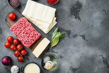Different Ingredients For Lasagna, On Gray Stone Background, Top View, Flat Lay, With Copy Space For Text