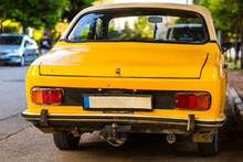 Taillight Details Of An Antique Car In Yellow