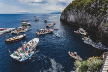 Tourists Waiting On The Boat Outside The Entrance To Blue Grotto A Sea Cave On The Coast Of The Island Of Capri In Southern Italy.