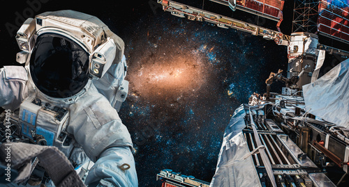Fotografie, Tablou Astronaut spaceman do spacewalk while working for space station in outer space