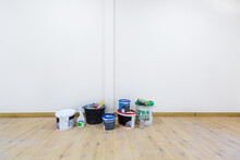 Cans With Paint For Wall, Solvent, Putty And Tools Are In Room That Is Under Construction, Remodeling, Renovation, Extension, Restoration And Reconstruction.