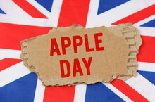 Against The Background Of The Flag Of Great Britain Lies Cardboard With The Inscription - Apple Day