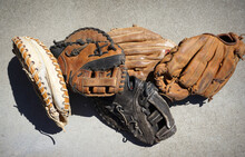Old Worn Baseball And Softball Gloves