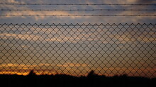 Sunset Through A Mesh Grid