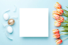 Easter Background Blue. Golden, White Colour Egg In Basket With Spring Tulips, Feathers On Pastel Blue Background In Happy Easter Decoration. Flat Lay, Top View.